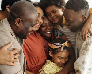 large family hugging group hug