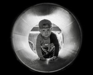 kid in tube tunnel