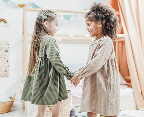 two young friends dancing